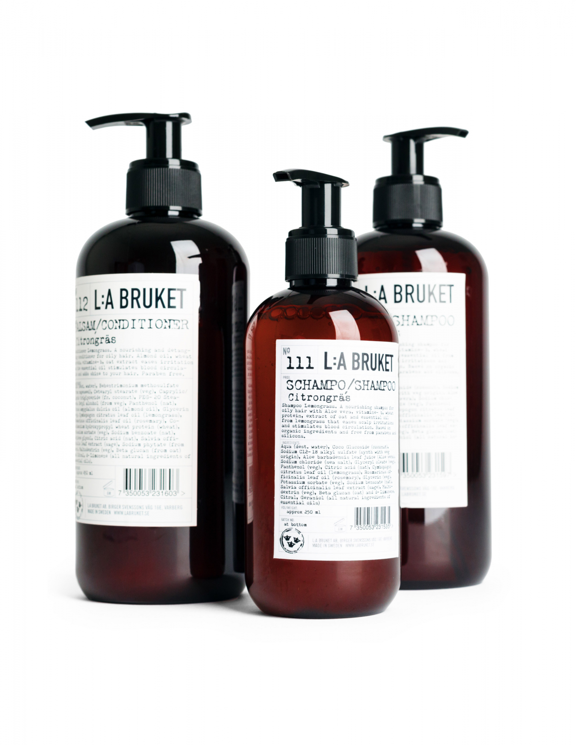 Three brown bottles in different sizes with pump, containing schampoo and conditioner.