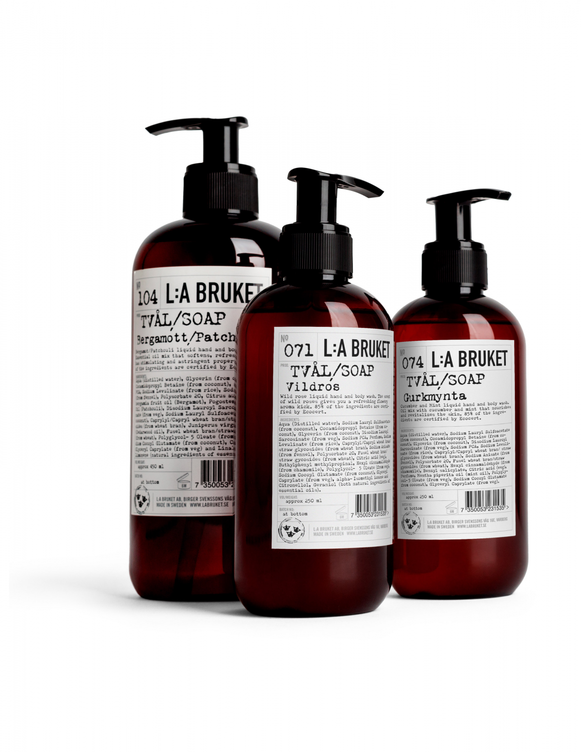 Three brown bottles in a group, containing liquid soap/body wash from L:a Bruket in different sizes.