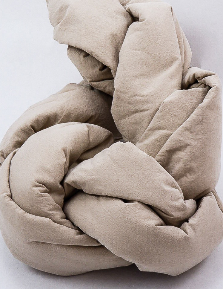 Duvet cover set in organic washed cotton in colour Sand as package.