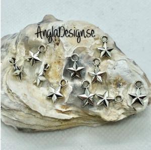 Berlock liten facetterad stjärna i antiksilver, 10-pack