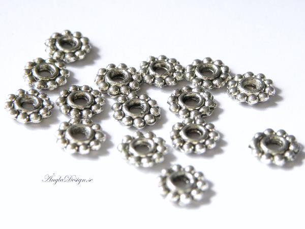 Mellandel daisy 6,5mm antiksilver, 20-pack