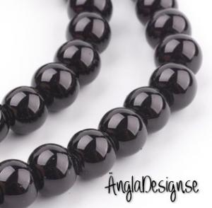 Vaxade glaspärlor 8 mm, svart 1 sträng
