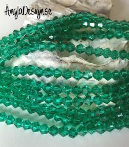 Glaspärla bicone Crystal 4mm mörkgrön, 1 sträng