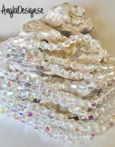 Glaspärla bicone Crystal 4mm klar med AB lyster, 1 sträng