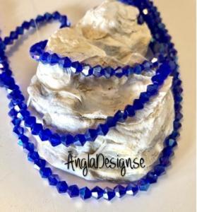 Glaspärla bicone Crystal 4mm mörkblå med AB lyster, 1 sträng