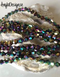 Glaspärla bicone Crystal 4mm multifärgad med elektropläterad lyster, 1 sträng