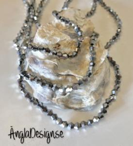 Glaspärla bicone Crystal 4mm silver med elektropläterad lyster, 1 sträng