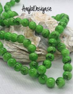 Glaspärla drawbench grön med svart stänk på, 6mm, 1 sträng