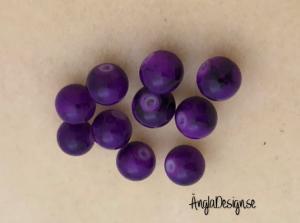 Glaspärla drawbench lila med svart stänk på, 8mm, 10-pack