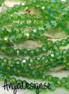 Glaspärla rund facetterad 4mm grön med AB lyster, 1 sträng