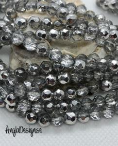 Glaspärla rund facetterad 6mm silver, 1 sträng