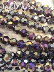 Glaspärla rund facetterad 6mm lila med AB lyster, 1 sträng