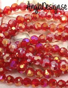 Glaspärla rund facetterad 6mm röd med AB lyster, 1 sträng