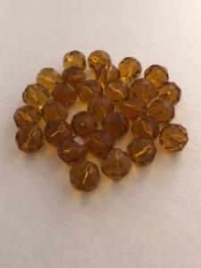Glaspärla facetterad rund 12mm bärnsten, 20-pack