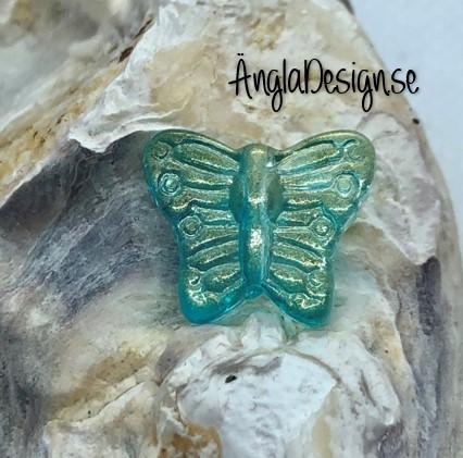 Glaspärla fjäril blå med guld lyster, 1st