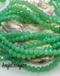 Glasrondell, facetterad 4x3mm imiterad jade grön,1 sträng