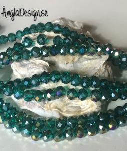 Glasrondell, facetterad 6x4mm emerald med AB lyster, 1 sträng