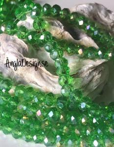Glasrondell, facetterad 6x4mm grön med AB lyster, 1 sträng