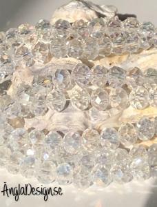 Glasrondell, facetterad 6x4mm klar med AB lyster, 1 sträng