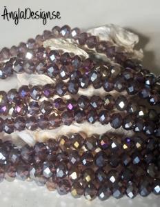 Glasrondell, facetterad 6x4mm lila med AB lyster, 1 sträng