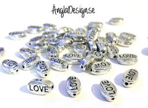 "Mellandel antiksilver, ""love"", 10-pack"