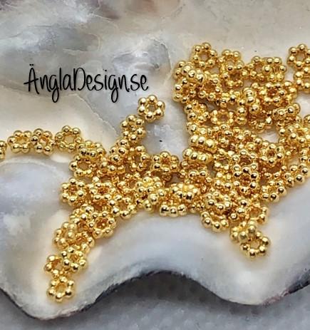 Mellandel mini daisy 3mm guldfärgad, 50-pack