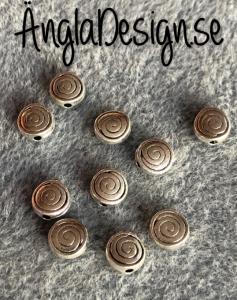 Mellandel antiksilver rund med spiralmönster, 10-pack