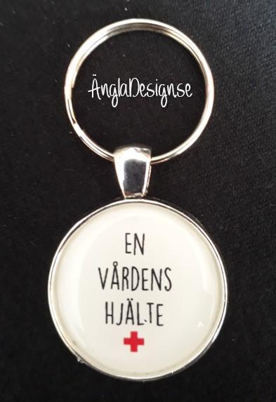 """Färdig nyckelring """"En vårdens hjälte"""", 1st"""