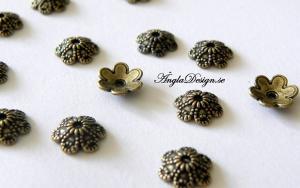 Pärlhatt brons, mönstrad blomma 10mm, 20st