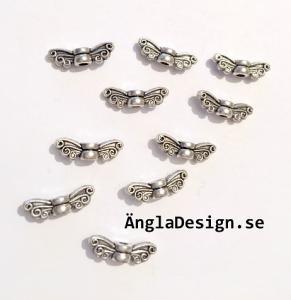 Mellandel antiksilver minivinge älva/ängla, 10-pack
