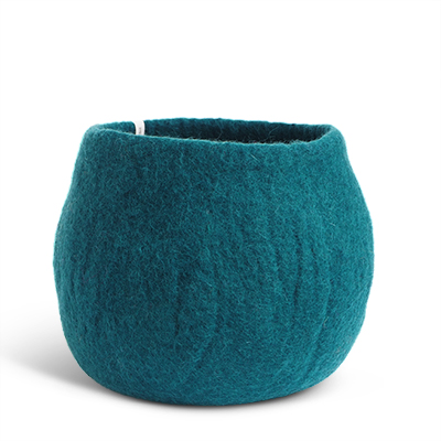 Large rounded flower pot in blue petrol made of wool.