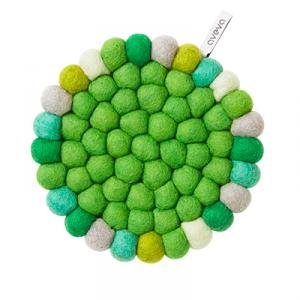 Round trivet in wool with green colors