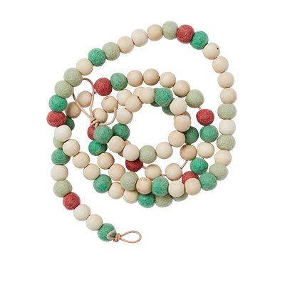 Handmade jewelry of wood and wool in coral and pistage green.