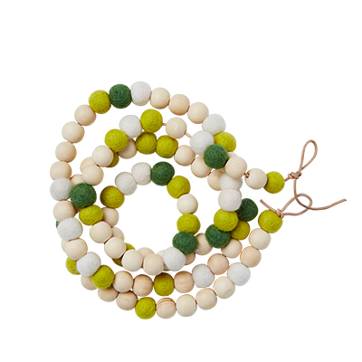 Handmade jewelry of wood and wool in lime and green.