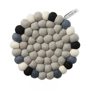 Round trivet in wool with different grey colors as well as black and white