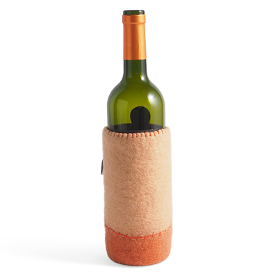Container made of wool to put bottles in - color nude / terracotta with wine bottle inserted.