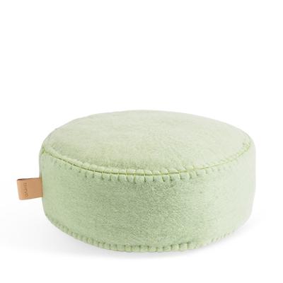 Round floor cushion in wool in sage green.