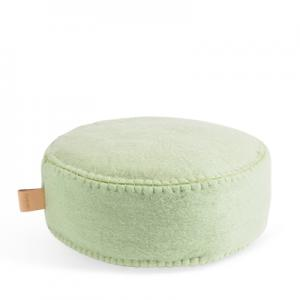Round floor cushion in wool in sage green.