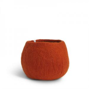 Medium size rounded flower pot in rust red made of wool.