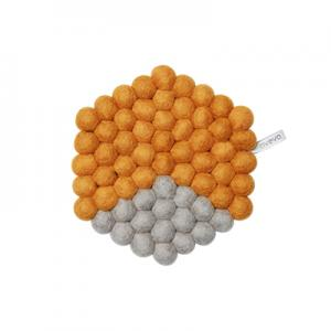 Grey and orange trivet in wool in hexagon shape