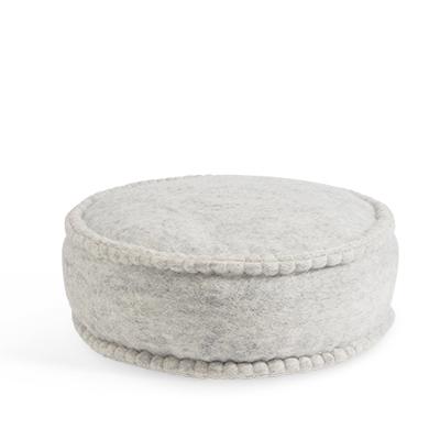 Round floor cushion in wool in grey.