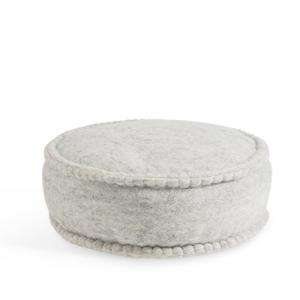 Round floor cushion in wool in grey.