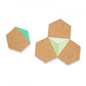 Coasters in hexagon made of light cork dipped in green color.