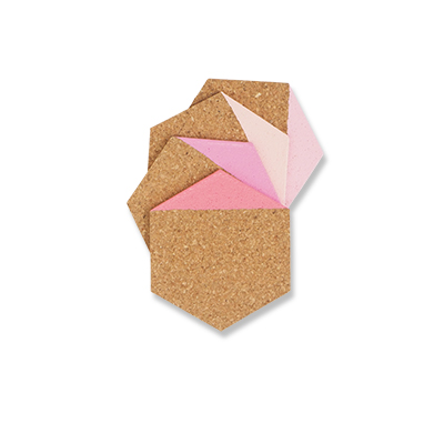 Coasters in hexagon made of light cork dipped in pink color.