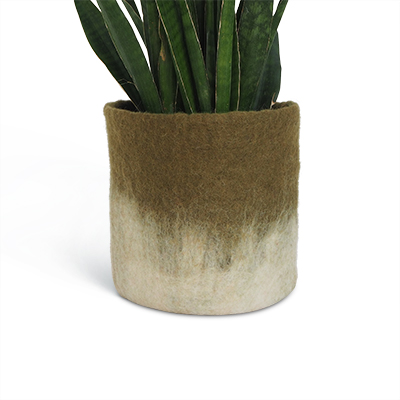 Large flower pot in olive green made of wool with ombre effect.