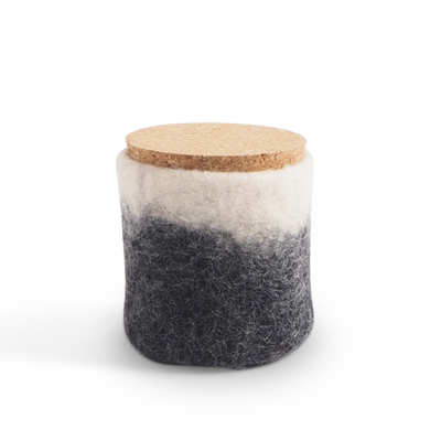 Handmade jar made of wool in dark grey and white ombre with a lid of light cork.