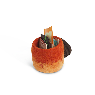 Handmade jar made of wool in rust ombre with a lid of cork and leather.