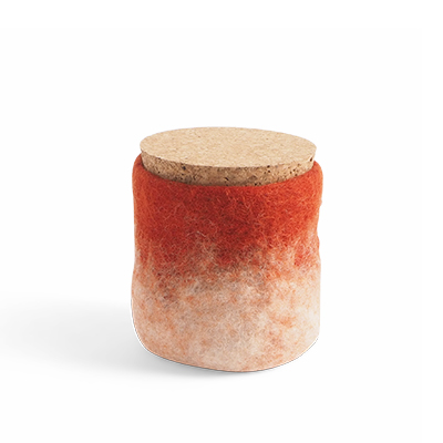 Handmade jar made of wool in rust red and white ombre with a lid of light cork.