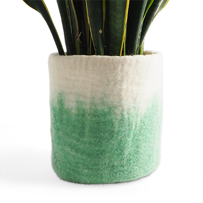 Large flower pot in pistache made of wool with ombre effect.