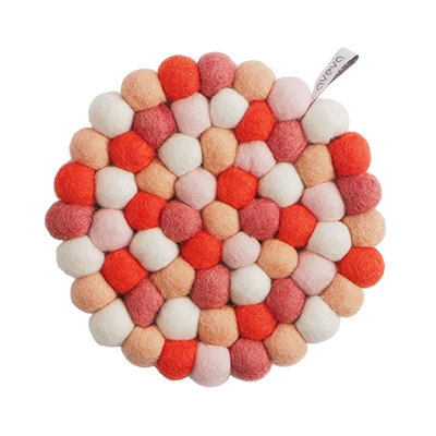 Round handmade trivet made of 100% wool - Mixed red and pink colors.
